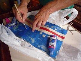 De vlag van Kaapverdie wordt bijgekleurd