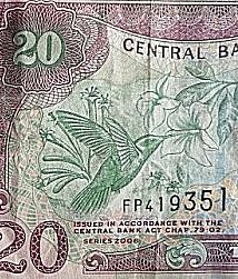 Het papier geld van Trinidad & Tobago heeft afbeeldingen van vogels.